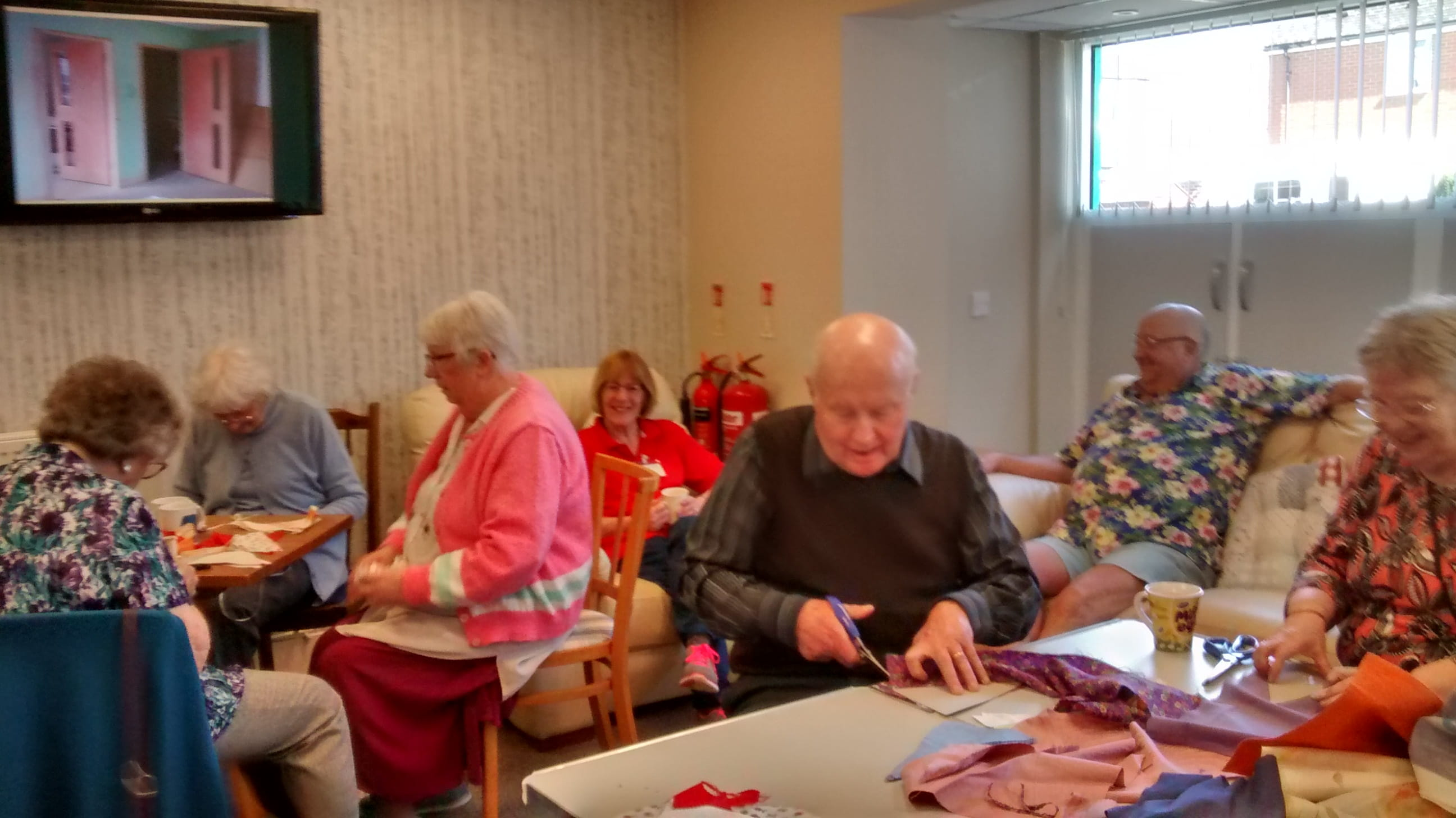 Memory Cafe folk making bunting for their street party